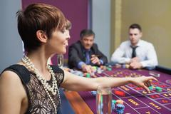 Woman placing a bet - stock photo
