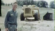 Stock Video Footage of PROUD EARTHMOVER OPERATOR Worker 1950s (Vintage Film Retro Home Movie) 4668
