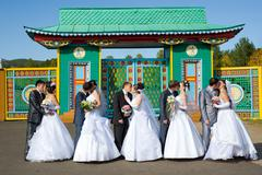 five kissing marrying couples - stock photo