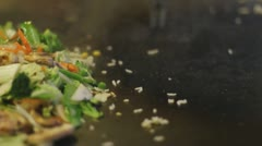 Japanese hibachi grilling - grilling vegetables and fried rice - stock footage