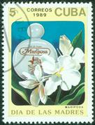 Stamp printed in Cuba shows a bottle of mariposa perfume Stock Photos
