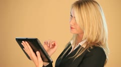 Blonde businesswoman on a tablet Stock Footage