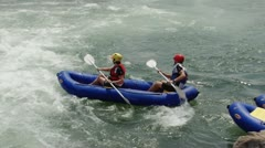 Whitewater rafting in river. - stock footage