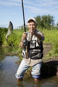 Fisherman fly fishing in a lake Stock Photos
