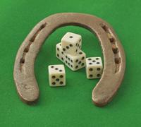 Horseshoe with dice Stock Photos