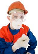 man in respirator smoking - stock photo