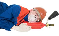 Sleeping laborer with fire extinguisheron Stock Photos