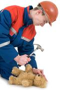 Labourer with bear and hammer Stock Photos
