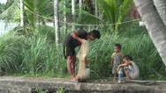 Laos fisherman with children at Don Khon island Stock Footage