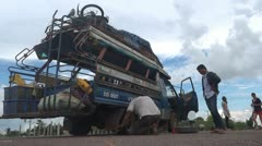 Changing wheel in Laos Stock Footage