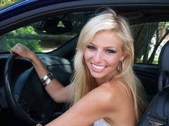 Smiling Blond in Car 02 - stock photo
