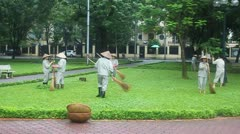 Workers clean a park Stock Footage