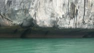 Karst formations and a boat in Halong Bay Stock Footage