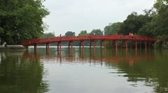 People go over Red Bridge in Hoan Kiem Lake Stock Footage