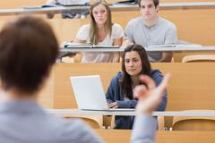 Stock Photo of Students sitting listening to the teacher