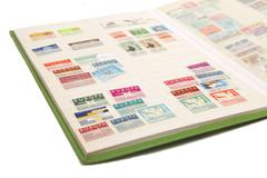 Album with postage stamps Stock Photos