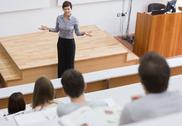 Stock Photo of Teacher standing talking to the students