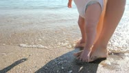 Baby feet on his mother`s feet learning to walk Stock Footage