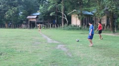 Children from Kong Lo village play soccer Stock Footage