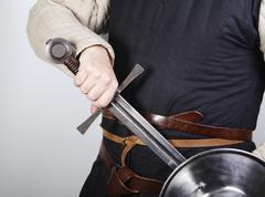 Unsheating a medieval sword Stock Photos