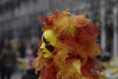 venice carnival sun in flames masquerade - stock photo