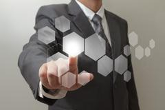Stock Illustration of hand pushing on  touch screen interface
