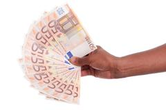 african hand holding money - stock photo