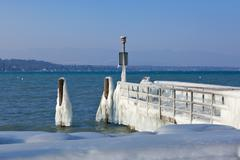 Very cold temperature give ice and freeze at the lake leman border Stock Photos