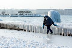 Children playing outside on winter in geneava Stock Photos