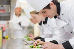 Culinary class in kitchen making salads - stock photo