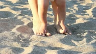 Mother feet holdind her baby feet learnig to walk Stock Footage