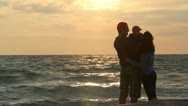 Stock Video Footage of Young couple and their baby at the seashore early morning