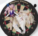 Stock Photo of Two Barbie Dolls in Wedding Dress and Office Wear on Dart Board with Darts