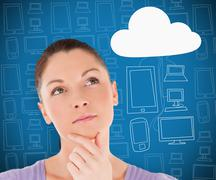 Stock Photo of Woman thinking about cloud computing