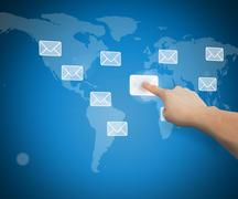 Hand selecting email from world map interface - stock illustration