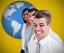 Businesspeople standing and smiling against yellow background - stock photo