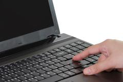Stock Photo of closeup of business woman typing on laptop keyboard