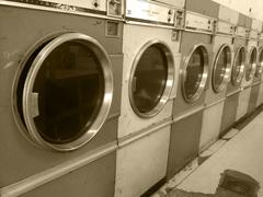 Vintage retro large washing machines commerical laundry mat - stock photo