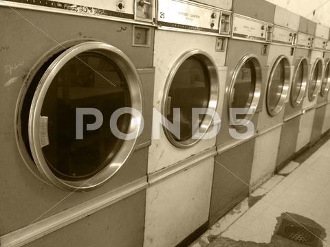Stock photo of Vintage retro large washing machines commerical laundry mat