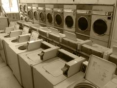 Vintage retro large washing machines & clothes dryers commercial laundry mat Stock Photos