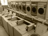 Stock Photo of Vintage retro large washing machines & clothes dryers commercial laundry mat