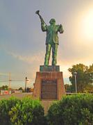 Green Louis Armstrong Statue with Trumpet at Dusk in Summer Stock Photos