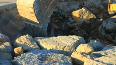Excavator operating in a rock quarry Stock Footage