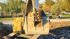 Excavator filling the sea Stock Footage