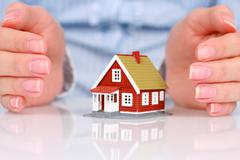 hands and house. - stock photo