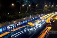 Stock Photo of busy big city traffic trail night