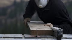 Carpenter Rips Plank of Spruce on Tablesaw Stock Footage