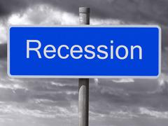 recession sign and a dark cloudy sky. - stock photo