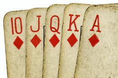 Royal flush old vintage poker cards close up. Stock Photos