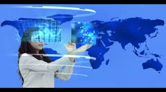 Woman searching through interactive media library on world map background Stock Footage